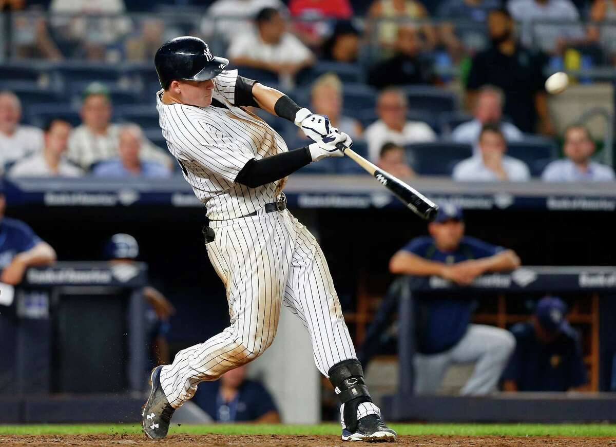 NEW YORK, NY - SEPTEMBER 08: Tyler Austin #26 of the New York Yankees connects on his ninth inning game winning home run against the Tampa Bay Rays at Yankee Stadium on September 8, 2016 in the Bronx borough of New York City. (Photo by Jim McIsaac/Getty Images) ORG XMIT: 607684821
