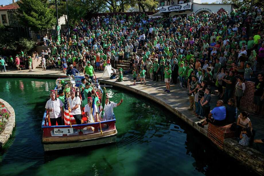 Murphy's Saint Patrick's Day Festival & River Parade, Co-Produced by The Harp & Shamrock Society and Paseo del Rio Association, provided music and entertainment for patrons Sunday Mach 13, 2016 at the Arneson Theatre. Hundreds of people gathered to celebrate St. Patrick's day  with eight decorated barges floating through the freshly-dyed green river. The day also included performances by Irish Kelly Singers, Ravenmoor and the Inishfree School, a competitive Irish dance school. Photo: Julysa Sosa/ For The San Antonio Express-News