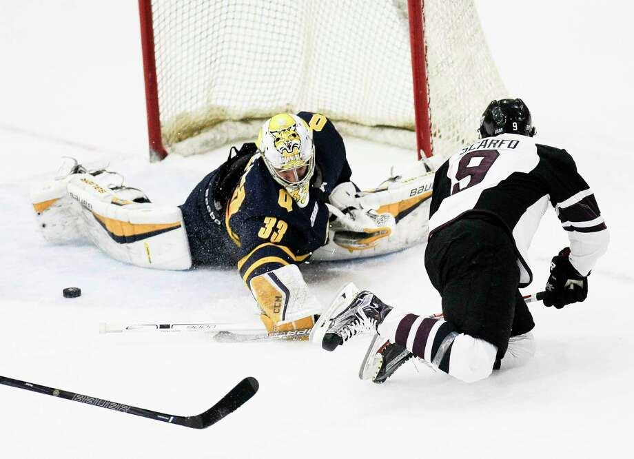 Quinnipiac  goalie Chris Truehl (33) blocks a shot by Union's Ryan Scarfo (9) in the first period of an NCAA college hockey game Friday, Feb. 17, 2017, in Schenectady, N.Y., (Hans Pennink / Special to the Times Union) ORG XMIT: HP101 Photo: Hans Pennink / Hans Pennink