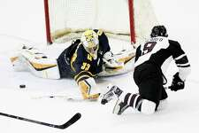 Quinnipiac  goalie Chris Truehl (33) blocks a shot by Union's Ryan Scarfo (9) in the first period of an NCAA college hockey game Friday, Feb. 17, 2017, in Schenectady, N.Y., (Hans Pennink / Special to the Times Union) ORG XMIT: HP101