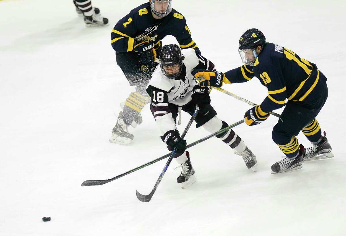 Union's Brett Supinski (18) moves the puck past Quinnipiac's Joe Fiala (3) and Chase Priskie (13) in the first period of an NCAA college hockey game Friday, Feb. 17, 2017, in Schenectady, N.Y., (Hans Pennink / Special to the Times Union) ORG XMIT: HP103