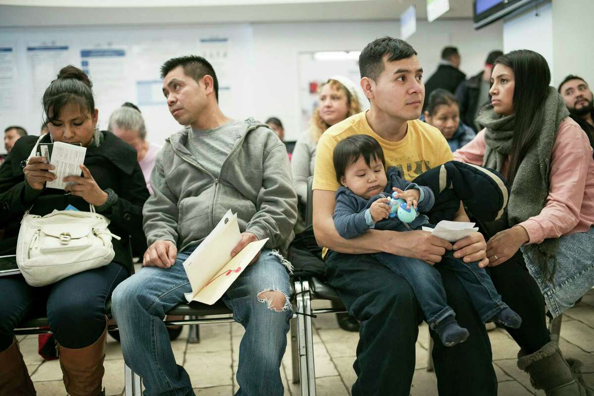 People wait Friday at the Mexican Consulate in New York. Mexican consulates across the country have been flooded with calls and visits from Mexican nationals worried about a crackdown on immigrants.