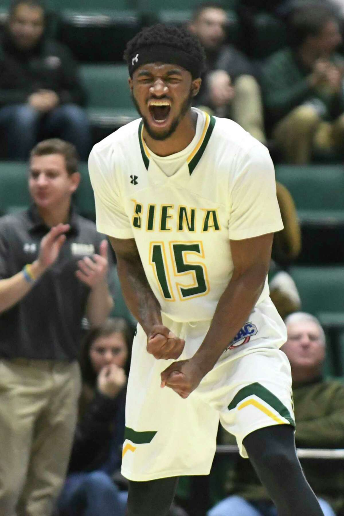 Siena's Nico Clareth celebrates a play during their basketball game against Bucknell on Saturday, Dec. 17, 2016, at Glens Falls Civic Center in Glens Falls, N.Y. (Cindy Schultz / Times Union)