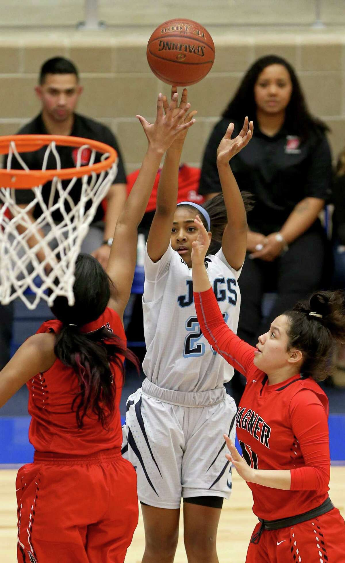 Johnson's Deja Kelly shoots between Wagner's Da'Nasia Hood (left) and Josline Hernandez during the Jaguars' win Friday. Kelly led all scorers with 25 points.