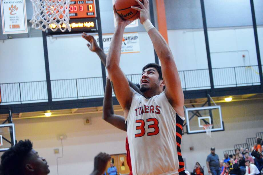 Edwardsville senior center AJ Epenesa goes up strong for a basket early in the third quarter of Friday's home game against Alton.