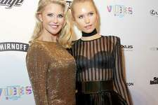 Christie Brinkley and daughter Sailor Brinkley Cook walk on Sports Illustrated Swimsuit Vibes red carpet Friday, Feb. 17, 2017, in Houston.