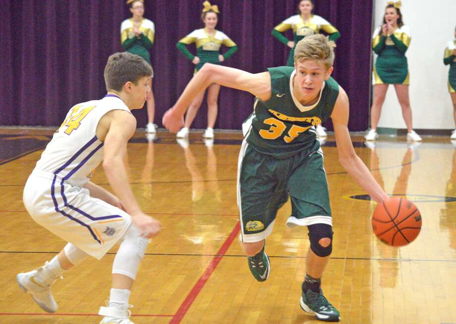 Metro-East Lutheran senior Noah Coddington tries to get past Mount Olive defender Quintin Kosowski during Friday's game at Mount Olive.