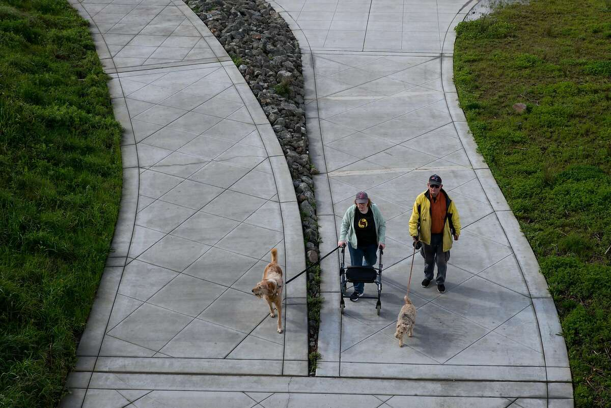People walk along the Napa Valley Vine Trail in Napa, Calif. on Thursday, Feb. 16, 2017. The Napa Valley Vine Trail runs along the Napa River through downtown.