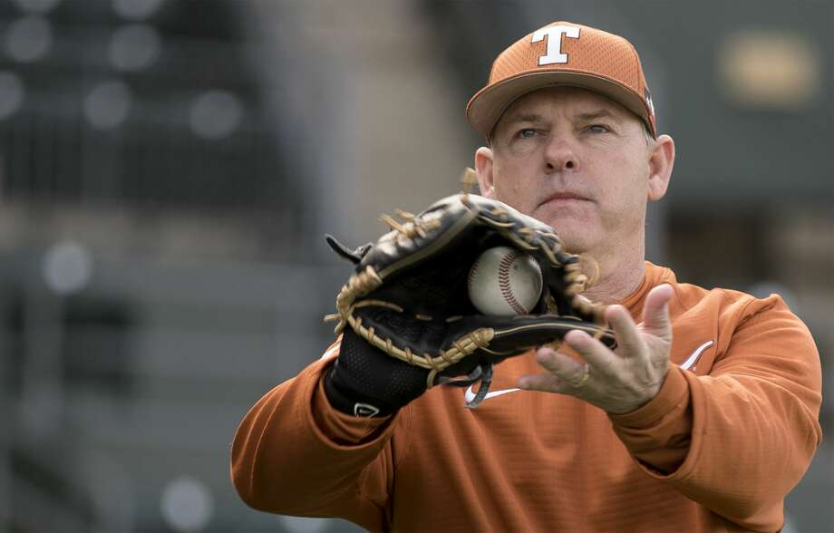 Texas head baseball coach David Pierce warms up during the first practice of the baseball season at UFCU Disch-Falk Field in Austin on Friday, January 27, 2017. Photo: Richard B. Brazziell/Austin American-Statesman