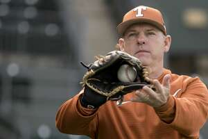 Texas head baseball coach David Pierce warms up during the first practice of the baseball season at UFCU Disch-Falk Field in Austin on Friday, January 27, 2017.