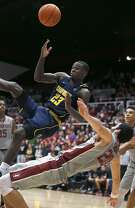 California guard Jabari Bird (23) collides with Stanford center Josh Sharma (20) during the second half of an NCAA college basketball game Friday, Feb. 17, 2017, in Stanford, Calif. Stanford won 73-68. (AP Photo/Tony Avelar)