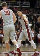 Stanford guard Dorian Pickens, right, celebrates with Grant Verhoeven (30) after scoring a 3-point shot against California during the second half of an NCAA college basketball game Friday, Feb. 17, 2017, in Stanford, Calif. Stanford won 73-68. (AP Photo/Tony Avelar)