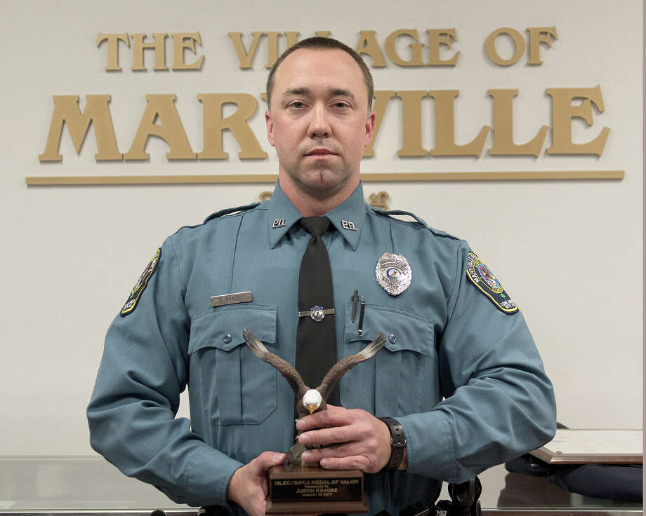 Maryville Police Officer Justin Krausz recently received the Medal of Valor Award from the Southern Illinois Police Chiefs' Association. Krausz received the award for his involvement in the arrest of a man after a high-speed chase and shootout. Photo: For The Intelligencer