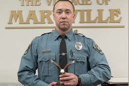 Maryville Police Officer Justin Krausz recently received the Medal of Valor Award from the Southern Illinois Police Chiefs' Association. Krausz received the award for his involvement in the arrest of a man after a high-speed chase and shootout.