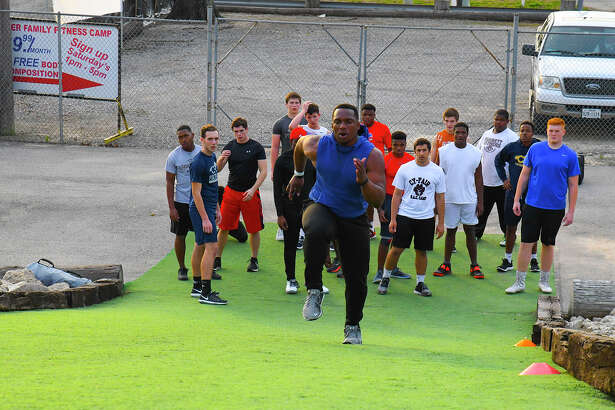 Pro Fit Houston trainer Cam Nwosu springs up the 60-yard hill at the training facility on North Eldridge. Nwosu stresses that the physical tools he and the other Pro Fit Houston trainers impart is only a piece of the total work players do.