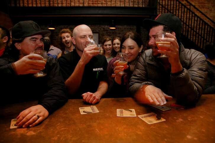 From left: Chris McCreary, John Stewartz, Meghan Dewey and Chrissy Bottorff drink Big Chicken Double IPA at Hopwater Distribution on Friday, Feb. 17, 2017, in San Francisco, Calif. A keg of newly released Big Chicken Double IPA from HenHouse Brewery was available on tap.
