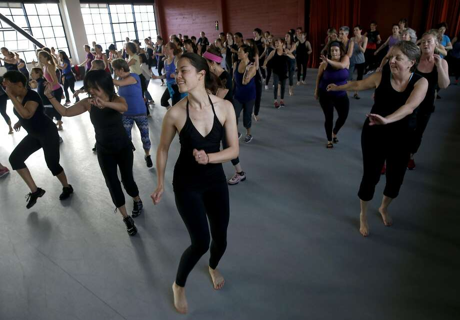 Minda Nicolas (center) dances in a Rhythm & Motion exercise class led by Amara Tabor-Smith at ODC studios in S.F. Photo: Paul Chinn, The Chronicle
