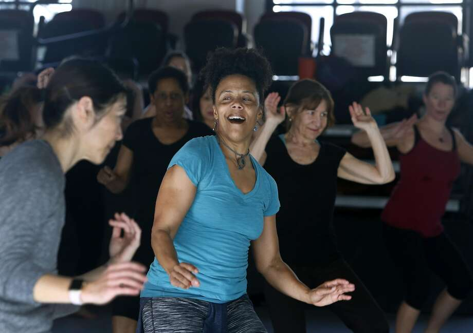 Amara Tabor-Smith leads a Rhythm & Motion exercise class at ODC Dance Commons in the Mission District. Many people are turning to dance as a way of relieving post-election stress. Photo: Paul Chinn, The Chronicle