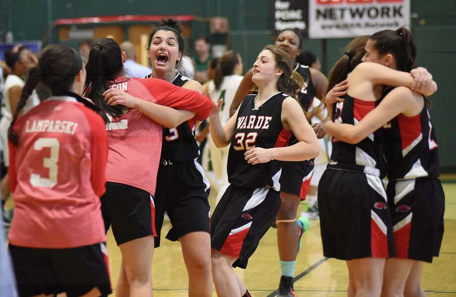 Members of the Fairfield Warde girls basketball team celebrates their 47-46 win over Norwalk in an FCIAC quarterfinal playoff game played at Scarso Gym in Norwalk. Photo: John Nash / Hearst Connecticut Media / Norwalk Hour