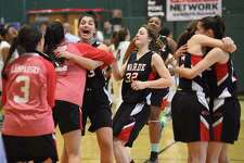 Members of the Fairfield Warde girls basketball team celebrates their 47-46 win over Norwalk in an FCIAC quarterfinal playoff game played at Scarso Gym in Norwalk.