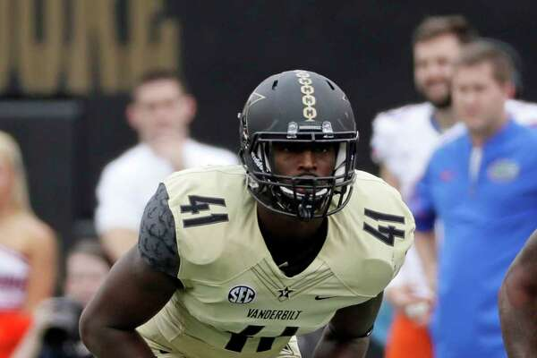 FILE - In this Oct. 1, 2016, file photo, Vanderbilt linebacker Zach Cunningham plays against Florida during an NCAA college football game in Nashville, Tenn. Cunningham has been among the nation's most productive defensive players and earned first-team AP All-America honors after making 119 tackles, including 16½ for a loss. Vanderbilt plays North Carolina State in the Independence Bowl on Monday. (AP Photo/Mark Humphrey, File)