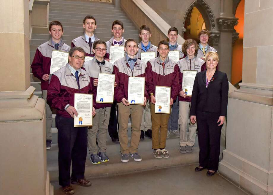 New York?s Class B Boys Cross-Country championship team from Burnt Hills-Ballston Lake High School  were honored at the state capitol  Feb. 14. Pictured are, front row, from left: Coach Chip Button, Ryan Leech, Luke Gobel, Tyler Berg, Evan Brennan and Walsh. Second row:  Nick Hunziker, Michael Bashant, Michael Messere, Kevin Board,  Aidan Gillooley and David Metacarpa.