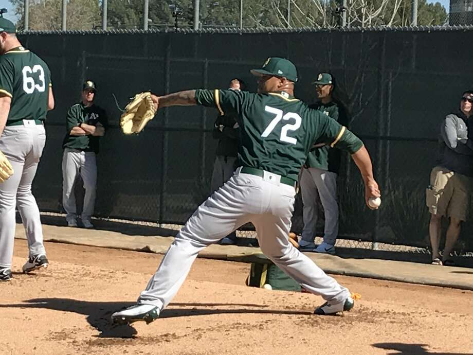 Frankie Montas, vying for the fifth spot in the A's rotation, throws a bullpen session on the first day of camp. Photo: Susan Slusser, Susan Slusser, The Chronicle