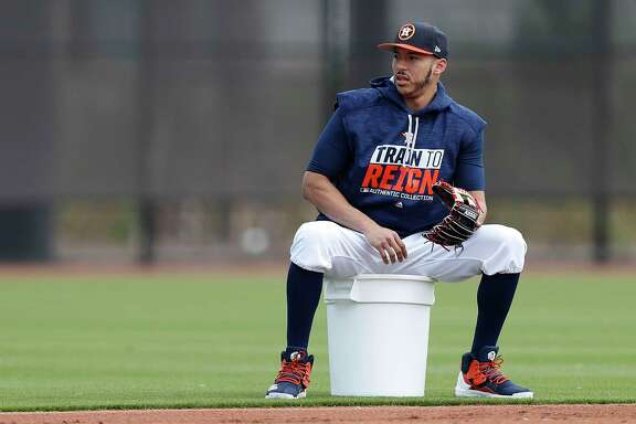 Houston Astros shortstop Carlos Correa watches others workout during spring training at The Ballpark of the Palm Beaches, in West Palm Beach, Florida, Saturday, February 18, 2017.  Correa is recovering from having all four wisdom teeth removed a few days ago.