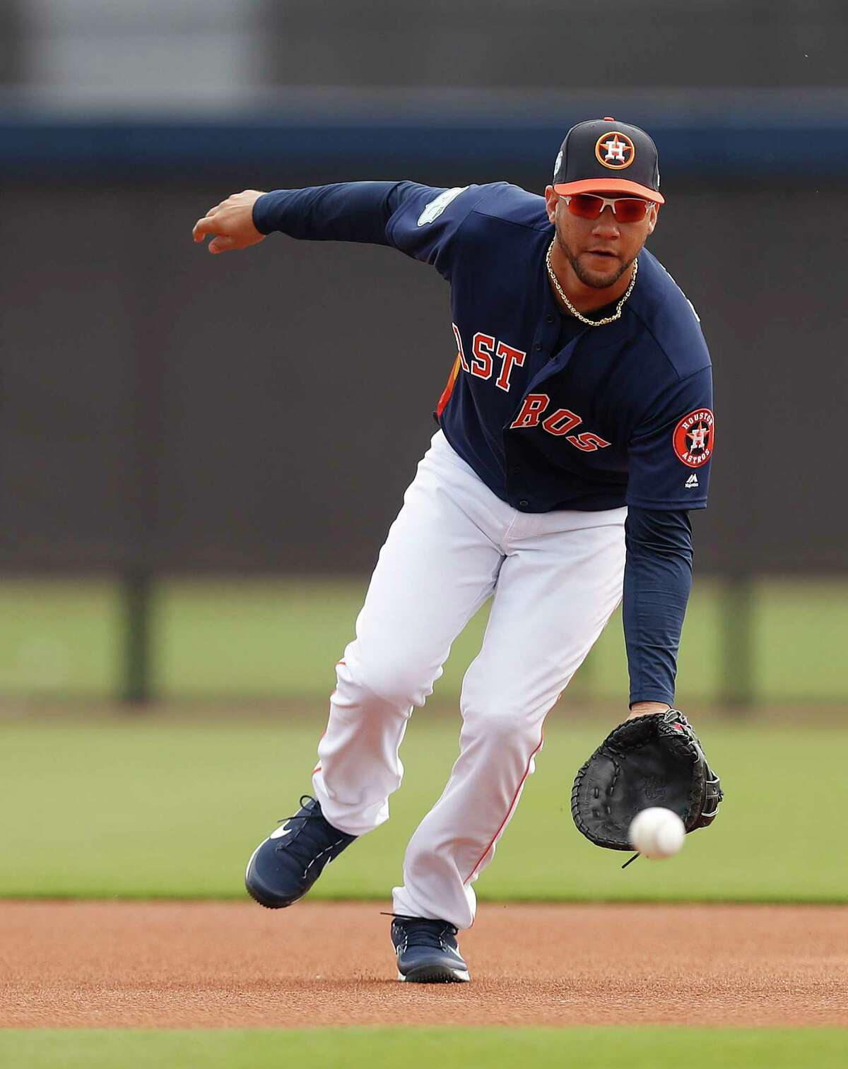 Houston Astros Yulieski Gurriel (10) catches a ground ball at first base during spring training at The Ballpark of the Palm Beaches, in West Palm Beach, Florida, Saturday, February 18, 2017.