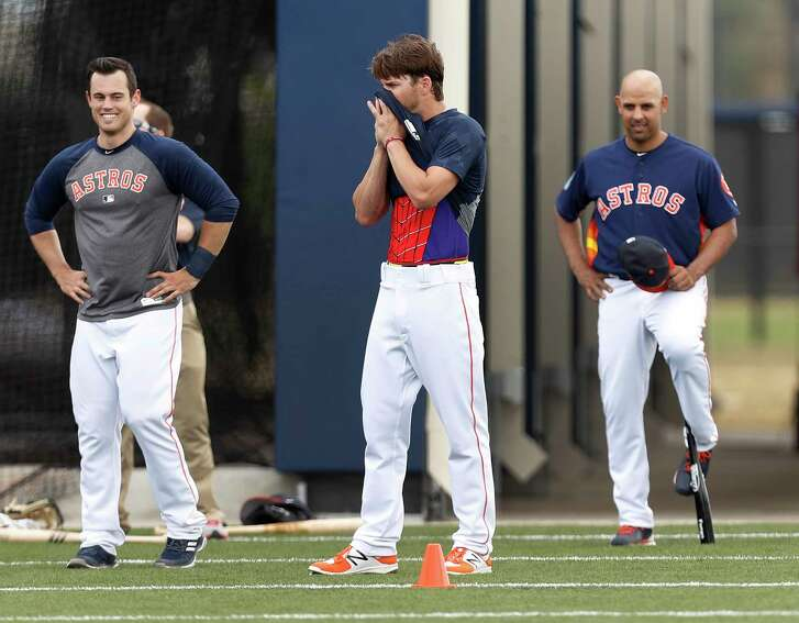 Houston Astros left fielder Josh Reddick (22) wipes sweat off his face with his shirt, revealing his Spiderman undershirt during spring training at The Ballpark of the Palm Beaches, in West Palm Beach, Florida, Saturday, February 18, 2017.