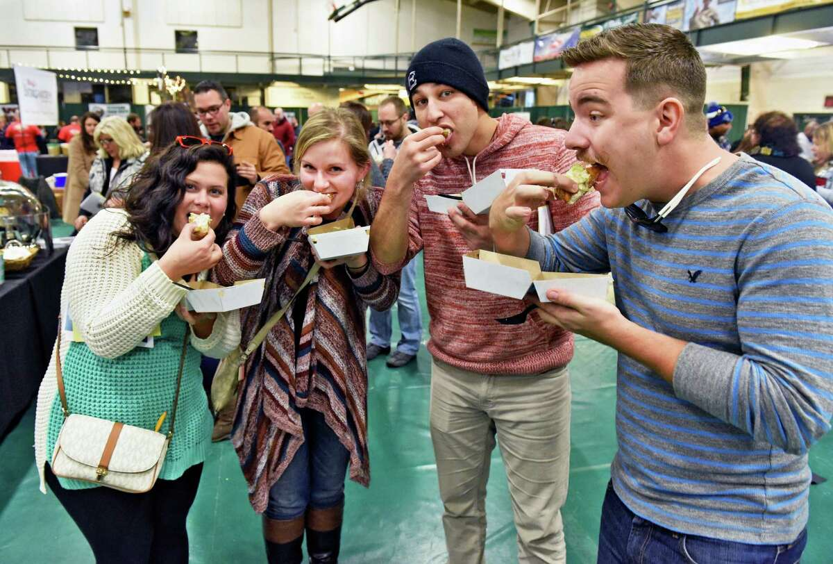 Sampling the fare are, from left, Drew Bradford of Cleveland, Susan Falotico, of Delmar, Antonio Sanchez of Delmar and Sean Daly of Cleveland at the 8th Annual Mac-n-Cheese Bowl Saturday Feb. 18, 2017 in Colonie, NY. (John Carl D'Annibale / Times Union)