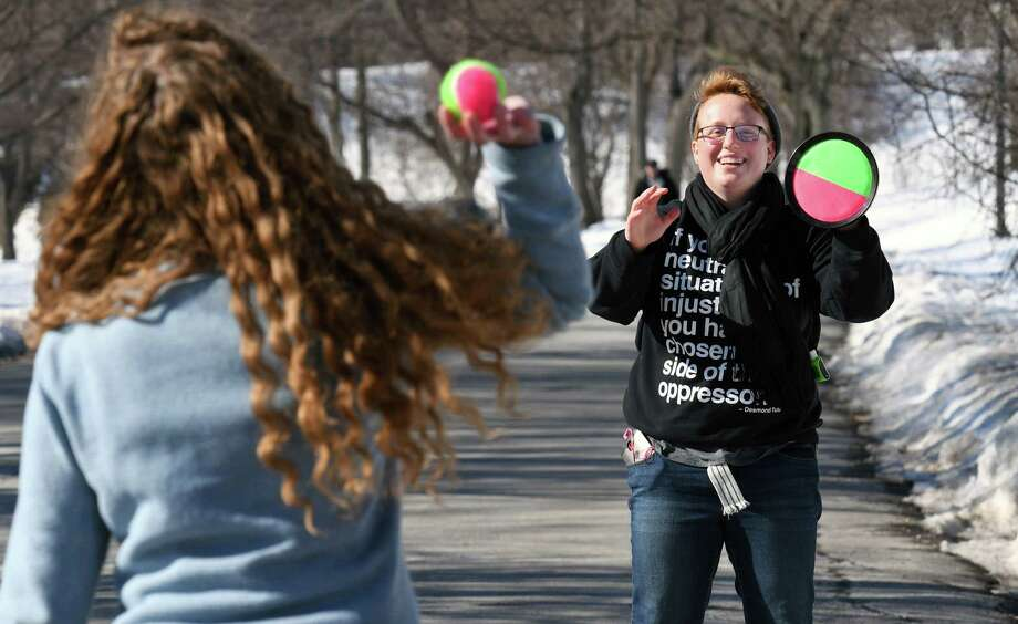 Taking advantage of the spring-like weather, RPI students Leah Henegar, left, and Rachael Vonada play velcro ball in Washington Park Saturday Feb. 18, 2017 in Albany, NY.  (John Carl D'Annibale / Times Union) Photo: John Carl D'Annibale