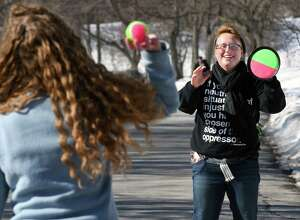 Taking advantage of the spring-like weather, RPI students Leah Henegar, left, and Rachael Vonada play velcro ball in Washington Park Saturday Feb. 18, 2017 in Albany, NY.  (John Carl D'Annibale / Times Union)