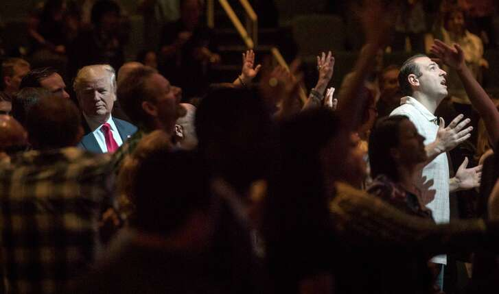 President Donald Trump, left, shown during a campaign event at the International Church of Las Vegas in October, has forged a strong alliance with the Christian right.