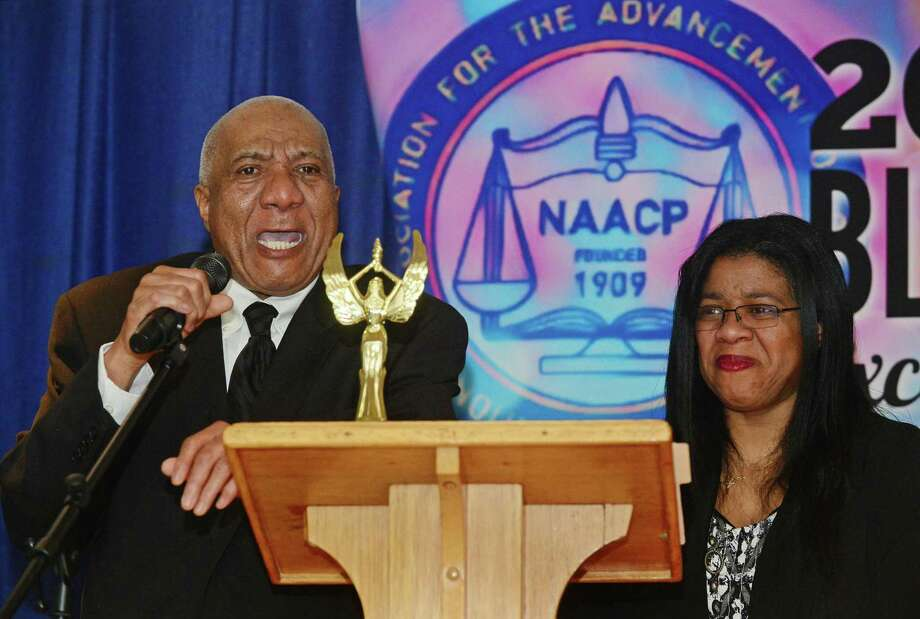John Mosby gives his acceptance speech after being presented the Lifetime Achievement Award by his daughter Shirley Mosby as the Norwalk Branch of the NAACP honors local heroes Saturday, Feb. 18, during the First Annual Black Excellence Awards at Grace Baptist Church in Norwalk. Photo: Erik Trautmann / Hearst Connecticut Media / Norwalk Hour