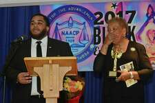 Jalin Sead recognizes Caroline Fuller and her late husband Richard Fuller as the Norwalk Branch of the NAACP honors local heroes Saturday, February 18, 2017, during the First Annual Black Excellence Awards at Grace Baptist Church in Norwalk, Conn.