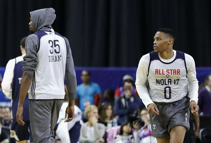 NEW ORLEANS, LA - FEBRUARY 18:  Kevin Durant #35 of the Golden State Warriors (L) and Russell Westbrook #0 of the Oklahoma City Thunder attend practice for the 2017 NBA All-Star Game at the Mercedes-Benz Superdome on February 18, 2017 in New Orleans, Louisiana.  (Photo by Ronald Martinez/Getty Images)