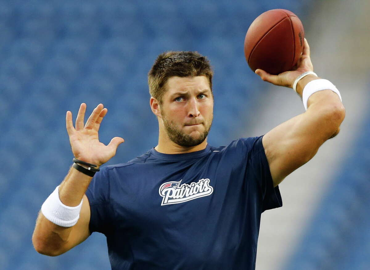 FOXBORO, MA - AUGUST 29: Tim Tebow #5 of the New England Patriots warms up prior to the preseason game against the New York Giants at Gillette Stadium on August 29, 2013 in Foxboro, Massachusetts. (Photo by Jared Wickerham/Getty Images) ORG XMIT: 173355147