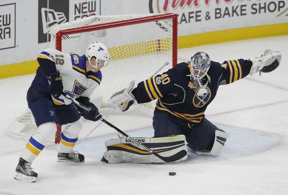 Buffalo Sabres goalie Robin Lehner stops St. Louis Blues forward Jori Lehtera during the third period of Buffalo's win, Photo: Jeffrey T. Barnes, Associated Press