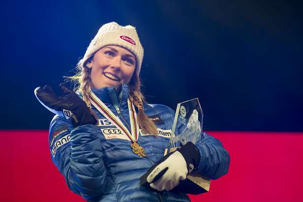 Gold medalist Mikaela Shiffrin of the USA, celebrates during the medal ceremony of the women's slalom at the 2017 FIS Alpine Skiing World Championships in St. Moritz, Switzerland, Saturday, Feb. 18, 2017. (Gian Ehrenzeller/Keystone via AP)