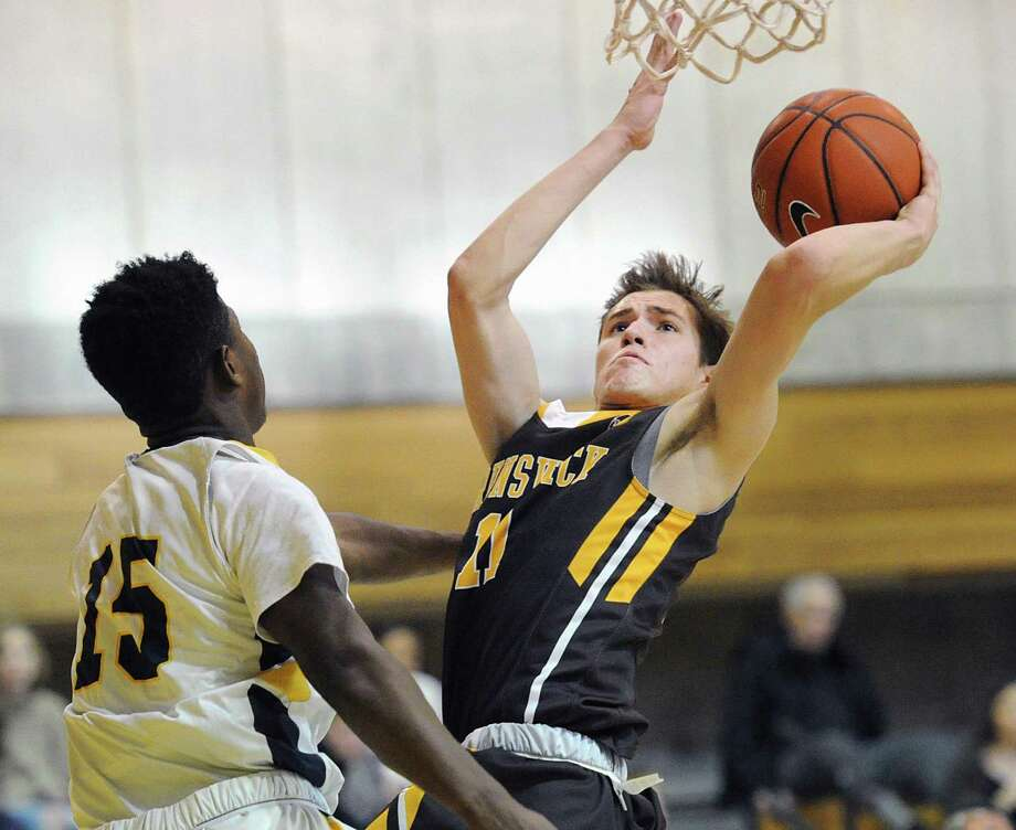 Brunswick's Graham Pierce (11), right, shoots and scores over a Trinity-Pawling defender Jon Girard (15) during the boys high school basketball game between Brusnwick School and Trinity-Pawling School at Brunswick in Greenwich, Conn., Saturday, Feb. 18, 2017. Photo: Bob Luckey Jr. / Hearst Connecticut Media / Greenwich Time