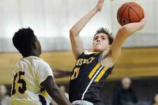 Brunswick's Graham Pierce (11), right, shoots and scores over a Trinity-Pawling defender Jon Girard (15) during the boys high school basketball game between Brusnwick School and Trinity-Pawling School at Brunswick in Greenwich, Conn., Saturday, Feb. 18, 2017.
