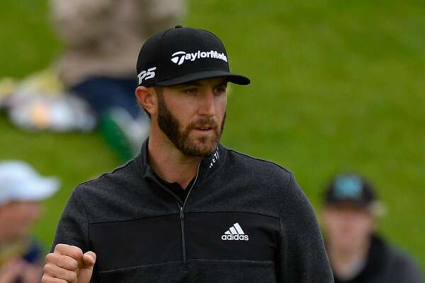 PACIFIC PALISADES, CA - FEBRUARY 18:  Dustin Johnson reacts to his birdie on the 18th hole during a continuation of the second round at the Genesis Open at Riviera Country Club on February 18, 2017 in Pacific Palisades, California.  (Photo by Robert Laberge/Getty Images)