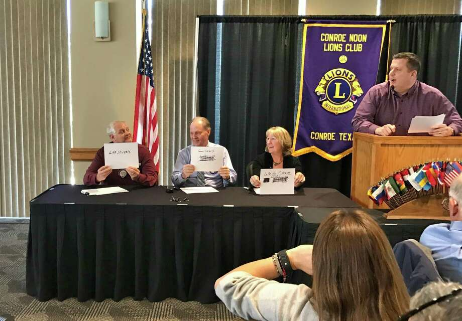 """The Conroe Noon Lions Club """"shook it up"""" Wednesday by playing a round of """"The Match Game"""" in an effort to learn more about the club and its members. Pictured (left to right) are Scott Perry, Steve Scott, Gail Cain and emcee Warner Phelps. Photo: Submitted"""