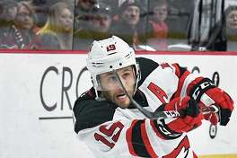 Albany Devils' #19 Carter Camper scores a goal during Saturday's game against the Bridgeport Sound Tigers at the Times Union Center Feb. 18, 2017 in Albany, NY.  (John Carl D'Annibale / Times Union)