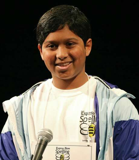 "Alex Iyer, 13, spells ""menagerie"" to win the 64th annual Express-News spelling bee held Saturday Feb. 18, 2017 at McAllister Auditorium on the San Antonio College campus. Photo: Edward A. Ornelas, Staff / San Antonio Express-News / © 2017 San Antonio Express-News"