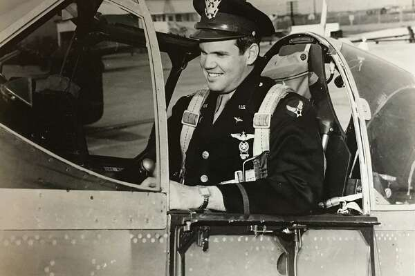 Bill Hensley, sitting in the cockpit of a fighter, served as a B-29 pilot in the Asian-Pacific Theater during World War II.