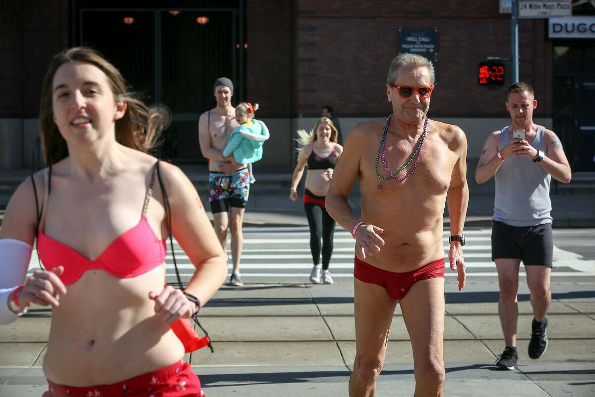 People run around AT&T Park in their undies as part of the Cupid's Undie Run fundraiser for the Children's Tumor Foundation on Saturday, February 18, 2017 in San Francisco, Calif.