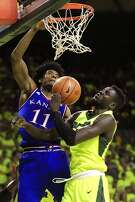 WACO, TX - FEBRUARY 18: Josh Jackson #11 of the Kansas Jayhawks dunks to score as Jo Lual-Acuil Jr. #0 of the Baylor Bears defends in the second half at the Ferrell Center on February 18, 2017 in Waco, Texas. Kansas won 67-65. (Photo by Ron Jenkins/Getty Images)