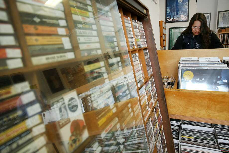Katie Styer browses the records at Park Boulevard Records in Oakland. Photo: Santiago Mejia, The Chronicle
